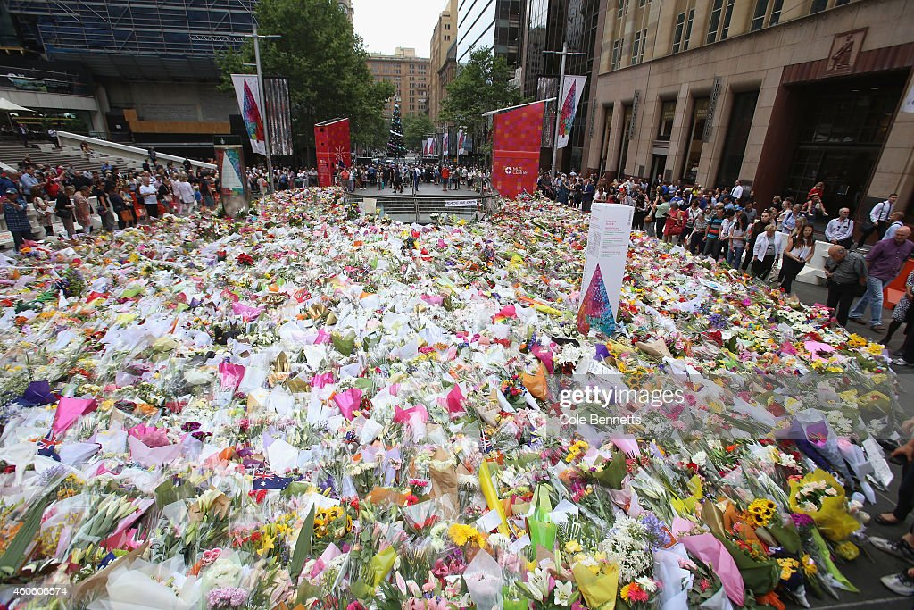 Thousands of floral tributes are seen in Martin Place on December 18 2014 in Sydney Australia Sydney siege gunman Man Haron Monis was shot dead by...