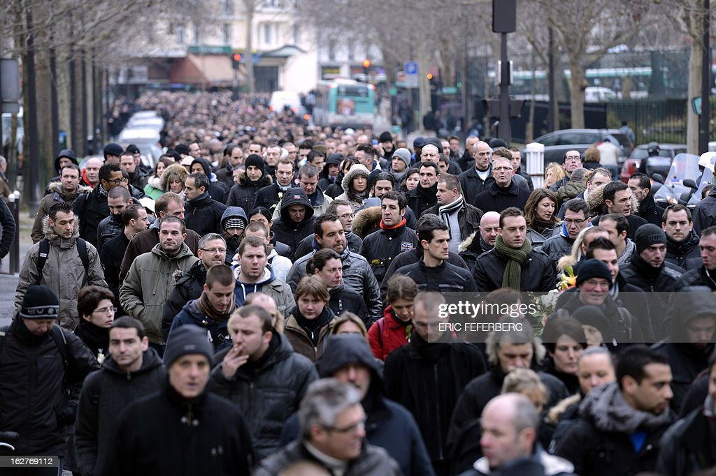 Thousands of French policemen take part in a silent march on February 26, 2013 in Paris, in the memory of two of their colleagues, killed in a collision five days before in Paris during a high-speed chase. An alleged drunk driver killed the two Paris police officers after slamming his black Land Rover into their cruiser during a high-speed chase on the ring road around Paris.