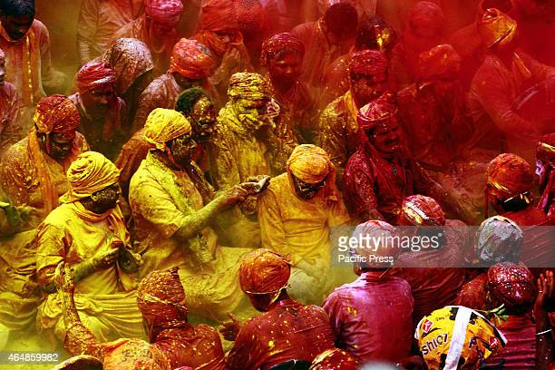 Thousands of Hindu devotees took part and celebrate 'Lathmar Holi' The colours fill the atmosphere as people throw abeer and gulal in the air showing...