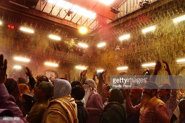 Thousands of Hindu devotees took part and celebrates Holi on Sunday at BankeBihari temple in Mathura The devotees were enjoys throwing colored...