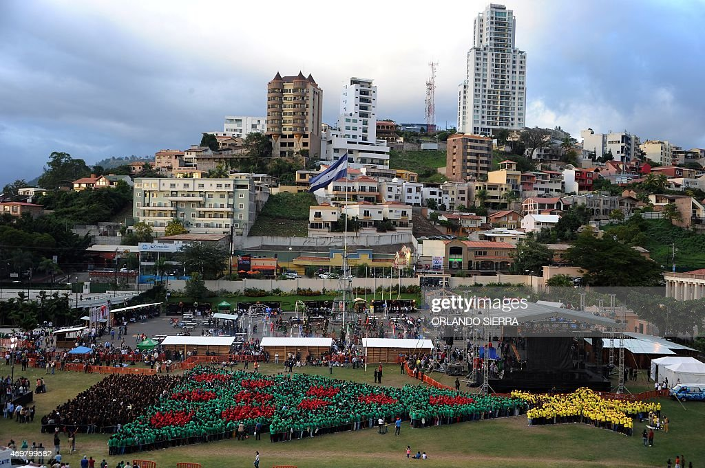 Thousands of Honduran people form the biggest human Christmas tree to set a new Guinness World Record at the Plaza La Democracia in Tegucigalpa on...