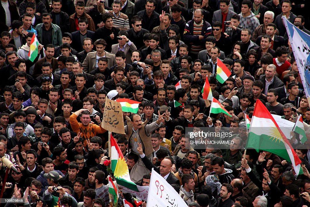 Thousands of Iraqi Kurdish anti-government protesters chant slogans and wave their flag as they demonstrate against the Kurdish region's leadership in the town of Sulaimaniyah in northern Iraq on March 7, 2011 a day after several tents erected by protesters demanding political reforms were set alight by masked assailants, according a spokesman for the demonstrators, who accused Kurdish security forces of being behind the attack. AFP PHOTO / SHWAN MOHAMMED
