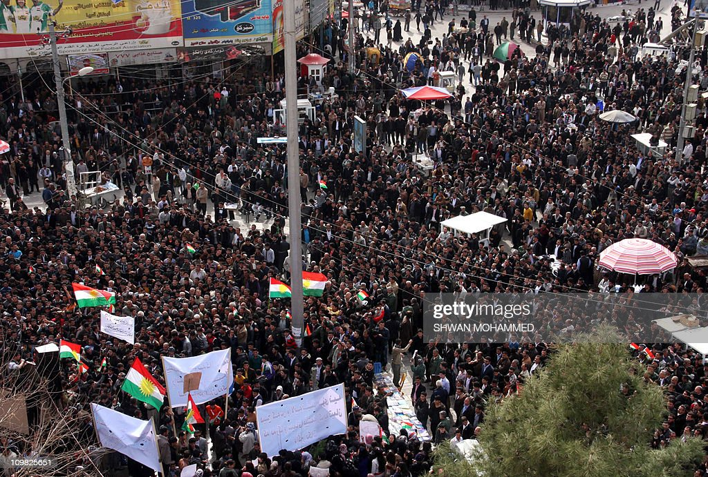 Thousands of Iraqi Kurdish anti-government protesters chant slogans and wave their flag as they demonstrate against the Kurdish region's leadership in the town of Sulaimaniyah in northern Iraq on March 7, 2011 a day after several tents erected by protesters demanding political reforms were set alight by masked assailants, according a spokesman for the demonstrators, who accused Kurdish security forces of being behind the attack.