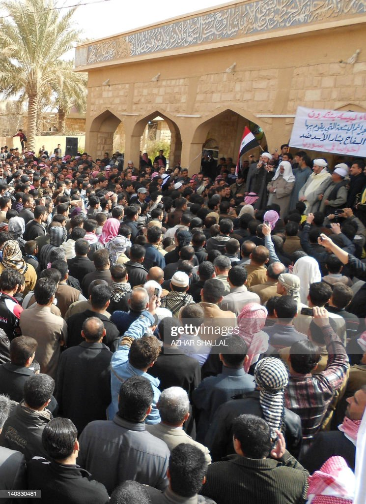 Thousands of Iraqis demonstrate on March 2, 2012 against Syrian President Bashar al-Assad in a protest in the mostly Sunni town of Heet, 100 kms west of the capital Baghdad, condemning a bloody crackdown on opposition by his regime. The protesters, who gathered outside Al-Faruq mosque in the centre of the western town in the Anbar province, shouted slogans describing the Syrian leader as a 'coward' and 'the enemy of God,' and called for violent resistance against his rule.