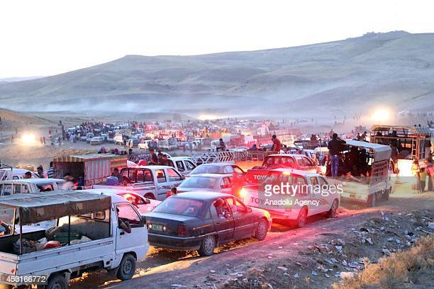 Thousands of Iraqis flee from the town of Sinjar near the city of Mosul to Erbil and Dohuk after armed groups affiliated with the Islamic State of...