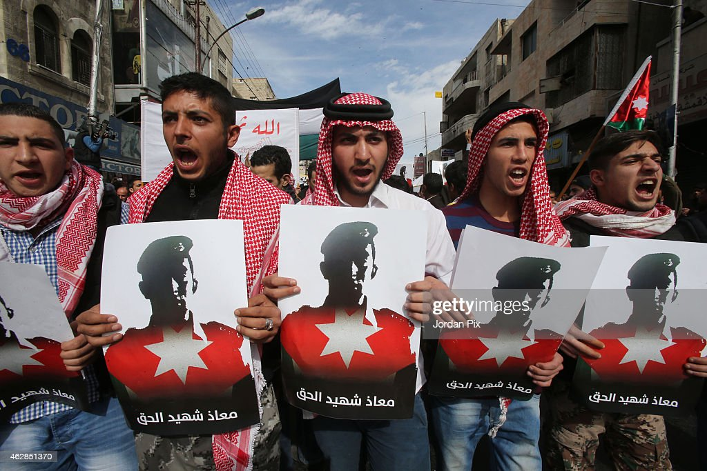 Thousands of Jordanians participate in a mass demonstration after Friday prayers near Al Hussein Mosque to express their solidarity with the pilot...