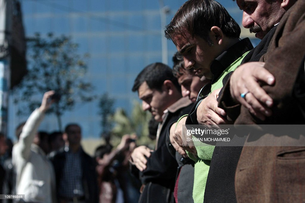 Thousands of Kurdish demonstrators perform the Friday prayer in the northern Iraqi Kurdish city of Sulaimaniya amid protests since February 17 demanding government reforms on March 4, 2011.