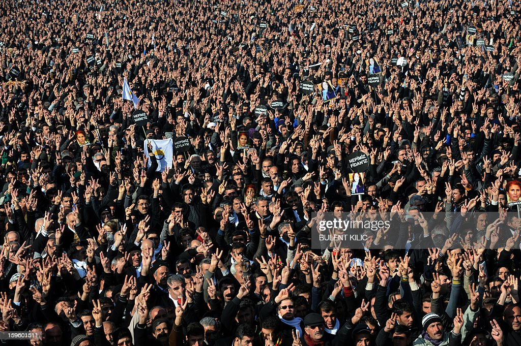 Thousands of Kurds attend the arrival of the coffins of the three top Kurdish activists, Sakine Cansiz, Fidan Dogan and Leyla Soylemez, shot dead in the French capital, on January 17 in Diyarbakir. Several thousand Kurds gathered Thursday in a square in Diyarbakir, the main city of Turkey's Kurd-majority southeast, to pay a final tribute to three Kurdish women activists who were assassinated in Paris last week. The growing crowd of participants, men and women adorned in white scarves, a symbol of peace, marched in a funeral many in Turkey feared would turn into a violent protest. The three women, one of them Sakine Cansiz, a co-founder of the outlawed Kurdistan Workers' Party (PKK), were found fatally shot, at least three times in their heads, at a Kurdish centre in Paris last week. French police were hunting the unknown assailants.