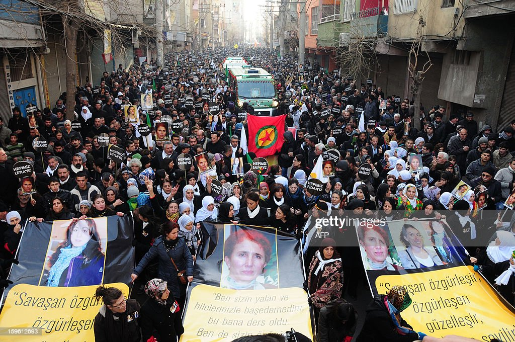 Thousands of Kurds carry banners bearing pictures of the three top Kurdish activists Sakine Cansiz, Fidan Dogan and Leyla Soylemez, shot dead in the French capital, on January 17 in Diyarbakir. Several thousand Kurds gathered on January 17 in a square in Diyarbakir, the main city of Turkey's Kurd-majority southeast, to pay a final tribute to three Kurdish women activists who were assassinated in Paris last week. The growing crowd of participants, men and women adorned in white scarves, a symbol of peace, marched in a funeral many in Turkey feared would turn into a violent protest. The three women, one of them Sakine Cansiz, a co-founder of the outlawed Kurdistan Workers' Party (PKK), were found fatally shot, at least three times in their heads, at a Kurdish centre in Paris last week. French police were hunting the unknown assailants.