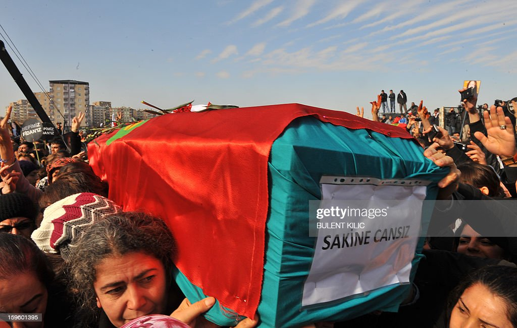 Thousands of Kurds carry the coffins of Sakine Cansiz, one of the three top Kurdish activists with Fidan Dogan and Leyla Soylemez, shot dead in the French capital, on January 17 in Diyarbakir. Several thousand Kurds gathered Thursday in a square in Diyarbakir, the main city of Turkey's Kurd-majority southeast, to pay a final tribute to three Kurdish women activists who were assassinated in Paris last week. The growing crowd of participants, men and women adorned in white scarves, a symbol of peace, marched in a funeral many in Turkey feared would turn into a violent protest. The three women, one of them Sakine Cansiz, a co-founder of the outlawed Kurdistan Workers' Party (PKK), were found fatally shot, at least three times in their heads, at a Kurdish centre in Paris last week. French police were hunting the unknown assailants.