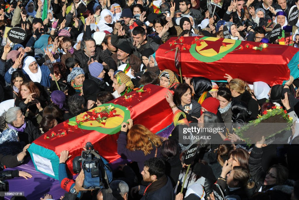 Thousands of Kurds carry the coffins of the three top Kurdish activists Sakine Cansiz, Fidan Dogan and Leyla Soylemez, shot dead in the French capital, on January 17 in Diyarbakir. Several thousand Kurds gathered Thursday in a square in Diyarbakir, the main city of Turkey's Kurd-majority southeast, to pay a final tribute to three Kurdish women activists who were assassinated in Paris last week. The growing crowd of participants, men and women adorned in white scarves, a symbol of peace, marched in a funeral many in Turkey feared would turn into a violent protest. The three women, one of them Sakine Cansiz, a co-founder of the outlawed Kurdistan Workers' Party (PKK), were found fatally shot, at least three times in their heads, at a Kurdish centre in Paris last week. French police were hunting the unknown assailants.