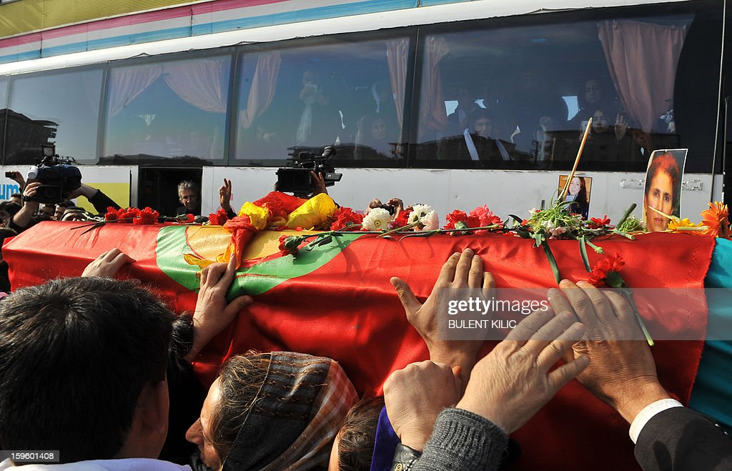 Thousands of Kurds carry the coffins of the three top Kurdish activists, Sakine Cansiz, Fidan Dogan and Leyla Soylemez, shot dead in the French capital, on January 17 in Diyarbakir. Several thousand Kurds gathered Thursday in a square in Diyarbakir, the main city of Turkey's Kurd-majority southeast, to pay a final tribute to three Kurdish women activists who were assassinated in Paris last week. The growing crowd of participants, men and women adorned in white scarves, a symbol of peace, marched in a funeral many in Turkey feared would turn into a violent protest. The three women, one of them Sakine Cansiz, a co-founder of the outlawed Kurdistan Workers' Party (PKK), were found fatally shot, at least three times in their heads, at a Kurdish centre in Paris last week. French police were hunting the unknown assailants. AFP PHOTO/BULENT KILIC