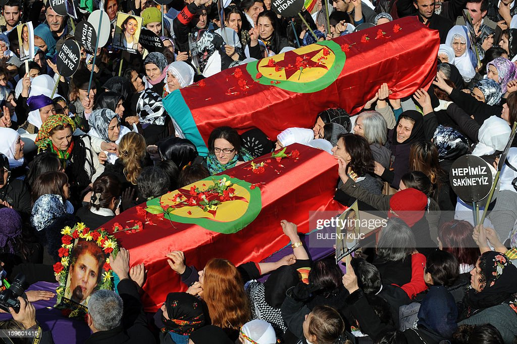 Thousands of Kurds carry the coffins of the three top Kurdish activists, Sakine Cansiz, Fidan Dogan and Leyla Soylemez, shot dead in the French capital, on January 17 in Diyarbakir. Several thousand Kurds gathered Thursday in a square in Diyarbakir, the main city of Turkey's Kurd-majority southeast, to pay a final tribute to three Kurdish women activists who were assassinated in Paris last week. The growing crowd of participants, men and women adorned in white scarves, a symbol of peace, marched in a funeral many in Turkey feared would turn into a violent protest. The three women, one of them Sakine Cansiz, a co-founder of the outlawed Kurdistan Workers' Party (PKK), were found fatally shot, at least three times in their heads, at a Kurdish centre in Paris last week. French police were hunting the unknown assailants.