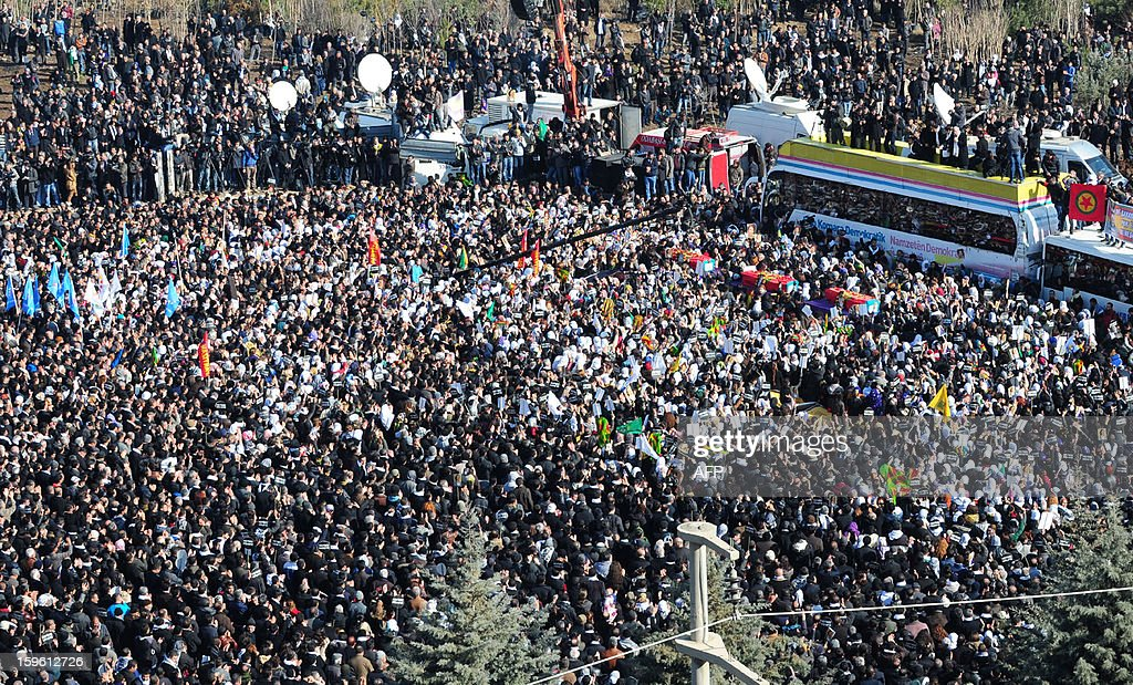 Thousands of Kurds carry the coffins of the three top Kurdish activists Sakine Cansiz, Fidan Dogan and Leyla Soylemez, shot dead in the French capital, on January 17 in Diyarbakir. Several thousand Kurds gathered on January 17 in a square in Diyarbakir, the main city of Turkey's Kurd-majority southeast, to pay a final tribute to three Kurdish women activists who were assassinated in Paris last week. The growing crowd of participants, men and women adorned in white scarves, a symbol of peace, marched in a funeral many in Turkey feared would turn into a violent protest. The three women, one of them Sakine Cansiz, a co-founder of the outlawed Kurdistan Workers' Party (PKK), were found fatally shot, at least three times in their heads, at a Kurdish centre in Paris last week. French police were hunting the unknown assailants. AFP PHOTO/MEHMET ENGIN