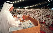 Thousands of Kuwaiti men gather 30 June 1999 at the tented elections headquarters to listen to former MP Mubarak alDuwaila's speech at his last...
