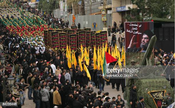 Thousands of Lebanese Shiite Hezbollah supporters march during an annual parade in the southern city of Nabatiyeh on January 10 2009 to mark the...