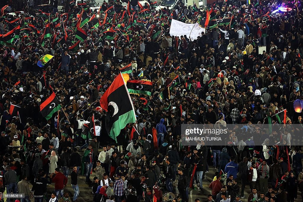 Thousands of Libyans celebrate the second anniversary of the Libyan uprising at Martyrs square on February 17, 2013 in Tripoli. Security forces were on high alert across Libya as the north African nation marked two years since the start of the revolt that toppled Moamer Kadhafi after four decades of iron rule. The anniversary of the uprising that ended with Kadhafi's killing in October 2011 comes as Libya's new rulers battle critics calling for a 'new revolution' and accusing them of failing to usher in much-needed reforms.
