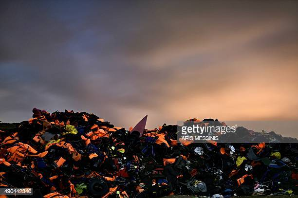 Thousands of life jackets from refugees and migrants form a small hill near the village of Molyvos in the island of Lesbos on September 28 2015 UN...