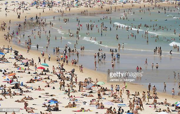 Thousands of locals and visitors to Sydney descend on iconic Bondi Beach to cool down in the water on January 11 2017 in Sydney Australia High...