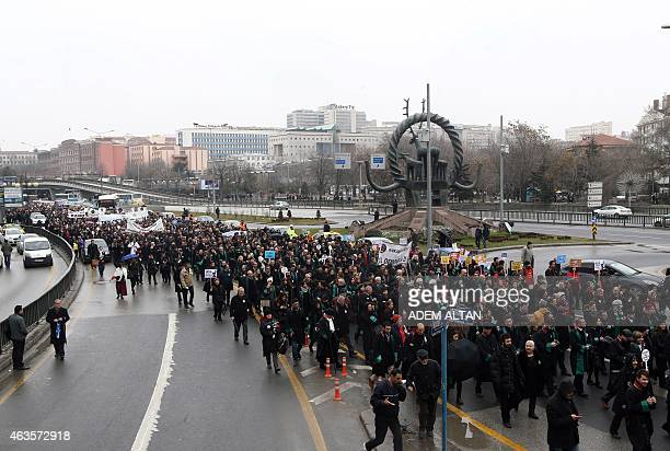 Thousands of members of Turkey's Bar Associations march to the parliament in Ankara on February 16 2015 to protest against a law that strenghtens the...
