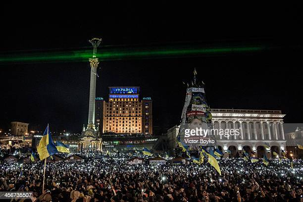Thousands of mobile phone flashlights light up the Maidan Square as the rock bank Okean Elzy perform live on stage on December 14 2013 in Kiev...