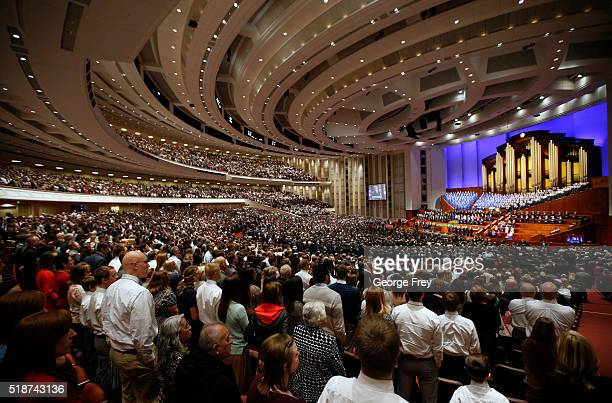 Thousands of Mormons sing with the Mormon Tabernacle Choir in the Conference Center during the 186th Annual General Conference of the Church of Jesus...