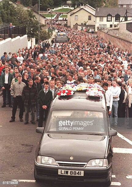 Thousands of mourners follow the coffin of Dermot McShane as it is carried from St Columbia Church to the City cemetry in Londonderry 15 July McShane...