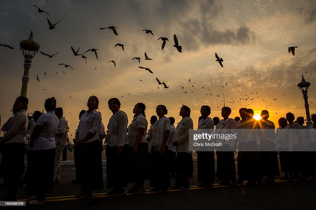 Thousands of mourners lineup at sunrise outside the Royal Palace before being allowed to enter the cremation site to pay their final respects to former King Norodom Sihanouk on February 3, 2013 in Phnom Penh, Cambodia. The former kings coffin was transported to the cremation site yesterday after being paraded through the capital in a lavish funeral procession. The cremation will take place on Monday the 4th of February, the funeral pyre will be lit by his wife and son King Norodom Sihamoni.