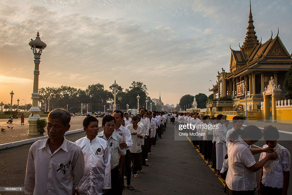 Thousands of mourners lineup before entering the cremation site to pay their final respects to former King Norodom Sihanouk on February 3, 2013 in Phnom Penh, Cambodia. The former kings coffin was transported to the cremation site yesterday after being paraded through the capital in a lavish funeral procession. The cremation will take place on Monday the 4th of February, the funeral pyre will be lit by his wife and son King Norodom Sihamoni.