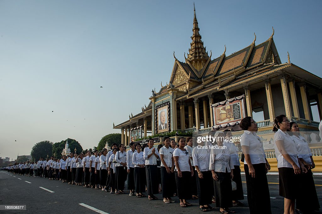 Thousands of mourners lineup outside the Royal Palace before being allowed to enter the cremation site to pay their final respects to former King Norodom Sihanouk on February 2, 2013 in Phnom Penh, Cambodia. The former kings coffin was transported to the cremation site yesterday after being paraded through the capital in a lavish funeral procession. The cremation will take place on Monday the 4th of February, the funeral pyre will be lit by his wife and son King Norodom Sihamoni.
