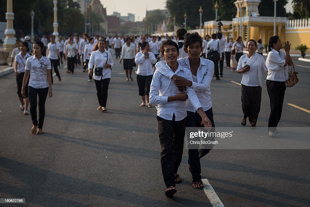 Thousands of mourners rush towards run to get to the front of the line to enter the cremation site to pay their final respects to former King Norodom Sihanouk ahead of tonight's cremation on February 4, 2013 in Phnom Penh, Cambodia. The former kings coffin was transported to the cremation site after being paraded through the capital in a lavish funeral procession. The cremation will take place on Monday evening the funeral pyre will be lit by his wife and son King Norodom Sihamoni.