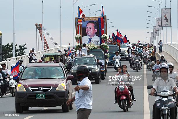Thousands of mourners take part in a funeral procession for slain prominent political analyst Kem Ley to mark 100 days since his death The people...