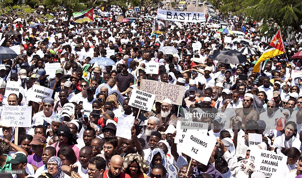 Thousands of Mozambicans take part in a nationwide march for peace on October 31, 2013 in Maputo, amid violent clashes between government troops and rebels who have taken up arms two decades after civil war. The Frelimo-led government recently launched an offensive against their civil war rivals Renamo, who after decades of peace launched a series of deadly attacks demanding a greater share of the country's wealth.