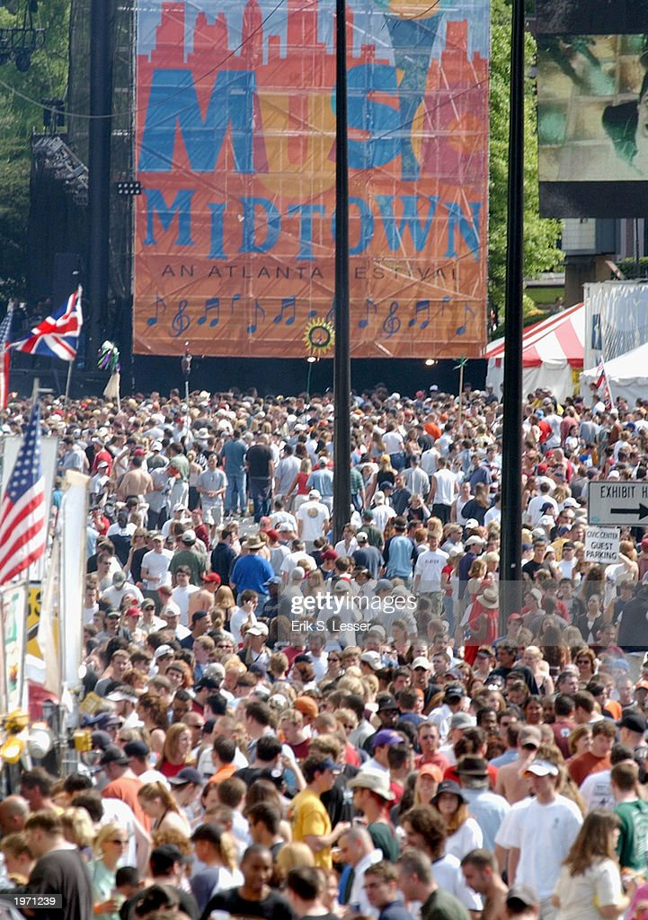 Thousands of music fans crowd into the 10th Annual Music Midtown Festival May 3, 2003 in Atlanta, Georgia. The three-day music festival features a variety of national acts.