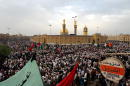 Thousands of Muslim Shias gather together in front of the Abbas Mosque during the annual pilgrimage which had been banned by Saddam Hussein for the...
