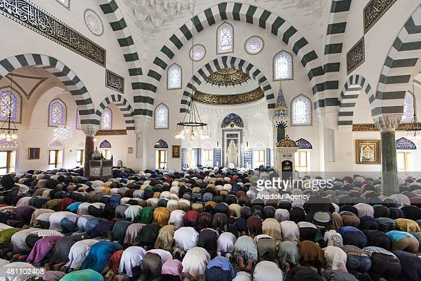Thousands of Muslims gather at the Turkish American Cultural Center Mosque to observe Eid alFitr during the holy month of Ramadan in Lanham Maryland...