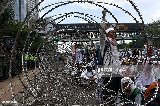 Thousands of Muslims held a demonstration in front of the Jakarta Metropolitan Police Headquarters as a support to their Imam Habib Rizieq Syihab who...