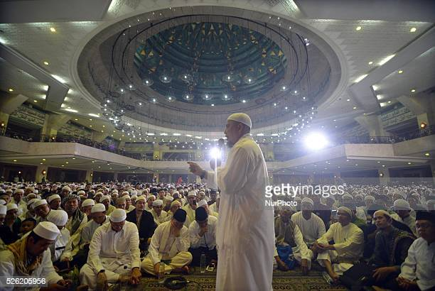 Thousands of Muslims praying with wisdom in the National Dhikr 2015 in Masjid AtTin Taman Mini Indonesia Indah In December 2015 National Dhikr become...