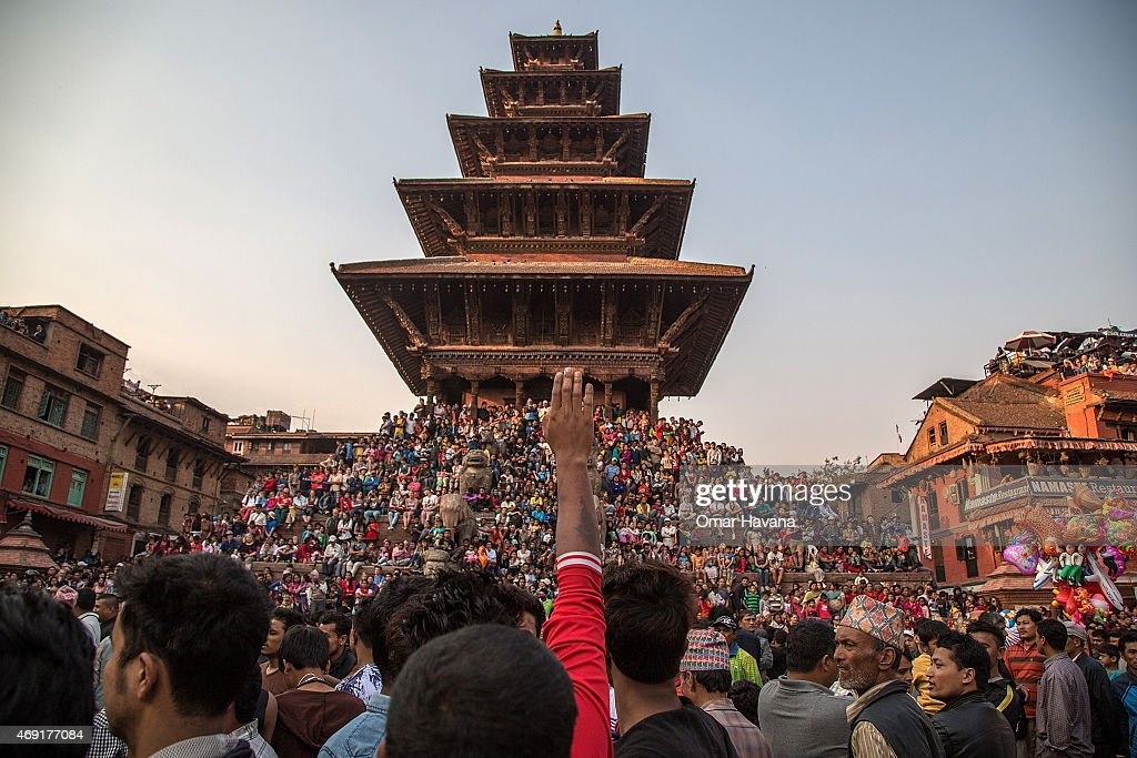 Thousands of Nepalese devotees attend the first day of the Bisket Jatra festival on April 10 2015 in Bhaktapur Nepal The Bisket Jatra festival is an...