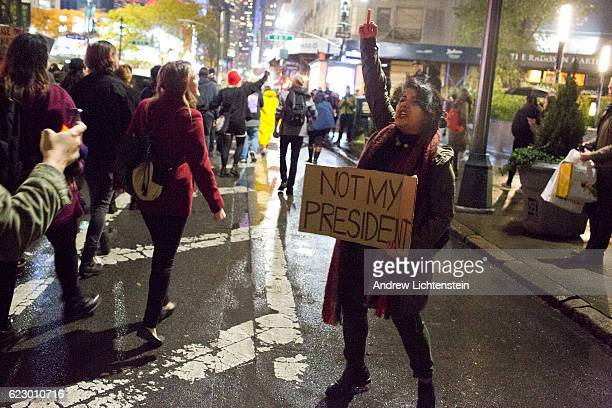 Thousands of New Yorkers shocked and angered by Donald Trump's presidential victory march through the streets of midtown to Trump Tower shouting 'Not...
