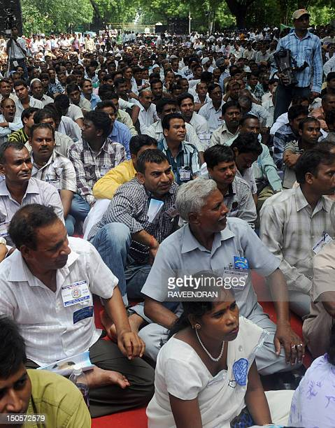 Thousands of of Scheduled Castes Scheduled Tribes Backward Classes and Indian Railway Employees Association take part in a rally in New Delhi on...
