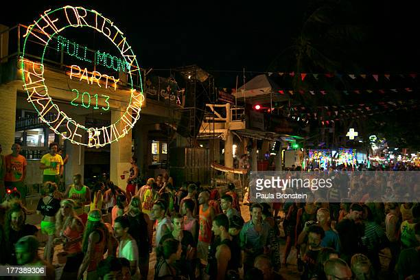 Thousands of people are attend the full moon party on the beach of Haad Rin on August 22 2013 on Koh Phangan Thailand Thousands of people from around...