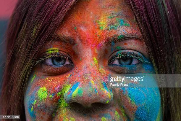Thousands of people at the second edition of the Turin Holi Fusion the Festival of Colors of Indian origin In photo a beautiful color girl
