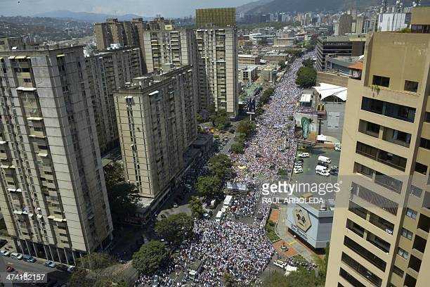 Thousands of people attend a march during a protest against the government of President Nicolas Maduro in Caracas on February 22 2014 Nationwide...