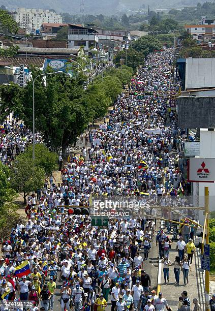 Thousands of people attend a march during a protest against the government of President Nicolas Maduro in San Cristobal capital of the western border...