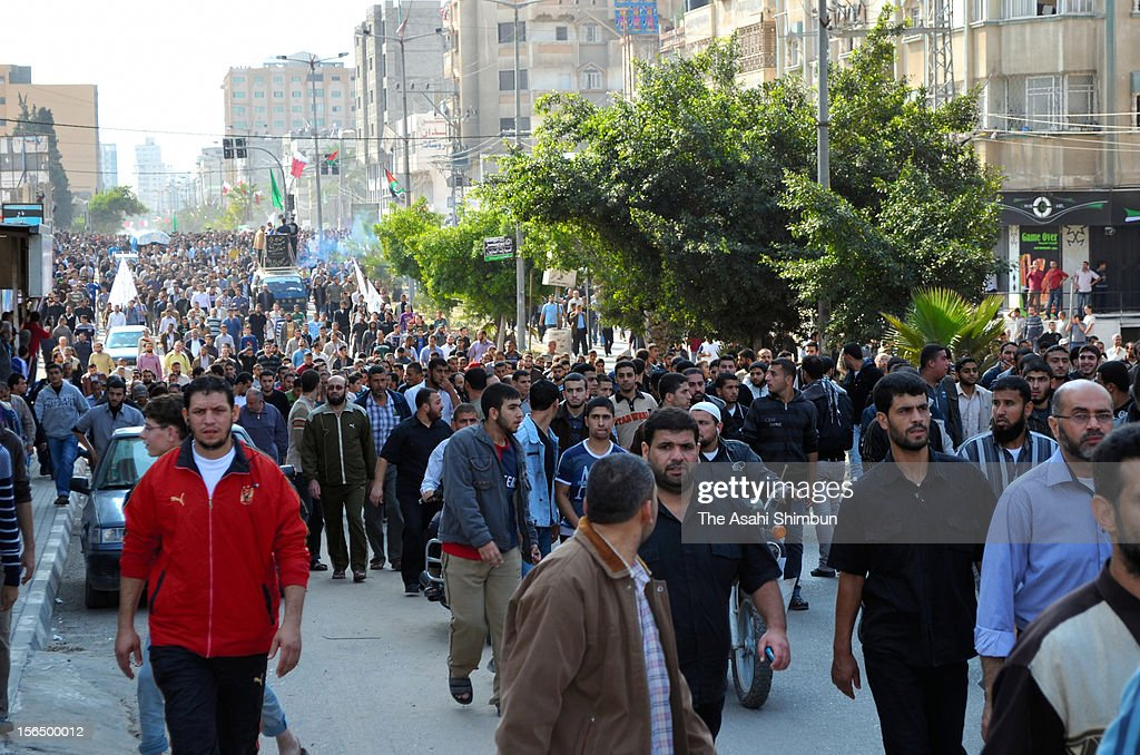 Thousands of people attend the funeral of Ahmed Jabari, a top military commander of Hamas on November 15, 2012 in Gaza City, Gaza. The IDF targeted nearly 200 sites in the Gaza Strip, killing Ahmed Jabari, Hamas responded with retaliatory missile attacks to Israel.