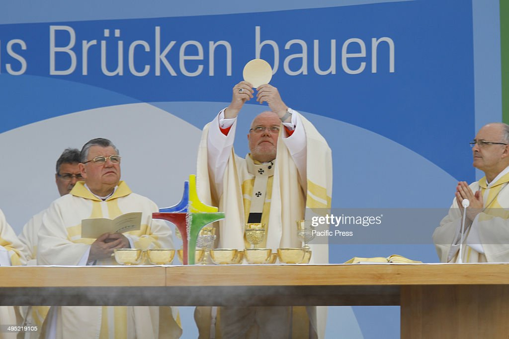 REGENSBURG, BAVARIA, GERMANY - : Thousands of people came to the closing open air mass of the 99th Deutscher Katholikentag (German Catholic Church Congress). The chief celebrant was Reinhard Marx, the Cardinal archbishop of Munich and Freising. The open air mass ended the 5 day congress.