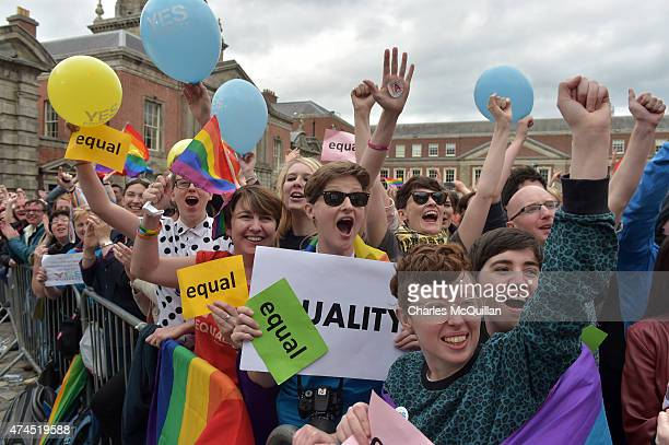 Thousands of people celebrate in Dublin Castle Square as the result of the referendum is relayed on May 23 2015 in Dublin Ireland Voters in the...