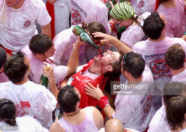 Thousands of people celebrate the 'Chupinazo' at the beginning of the San Fermin Festival on July 6 2005 in Pamplona Spain Every year fighting bulls...
