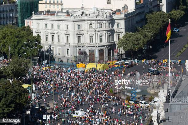 Thousands of people congregate in for the march of World Pride in Plaza de Cibeles